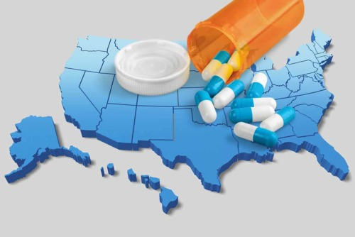 Map of the US and with pills scattered on it showing the Opioid Epidemic