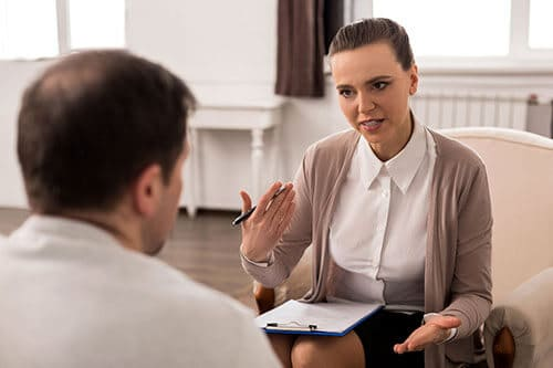 Counselor and client discussing how they will use psychodrama therapy during rehab