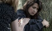 woman ponders psychological dependence to drugs and alcohol during addiction treatment
